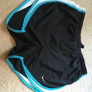 Nike Shorts - Nike black shorts with blue trim